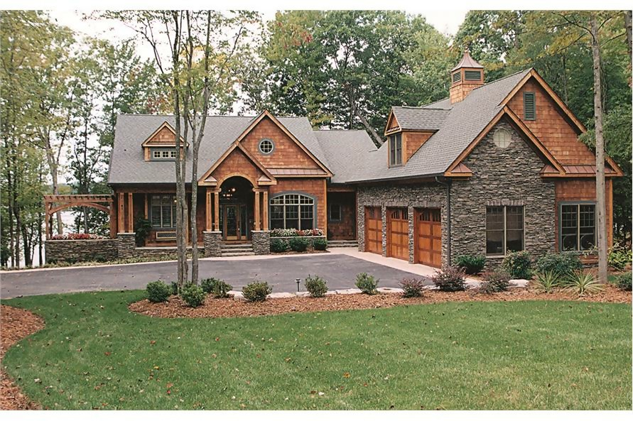 Rustic transitional Craftsman home with wood shingle and stone siding and a quaint cottage feel