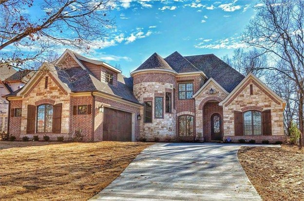 Amazing French Country Chateau style home with brick and stone exterior