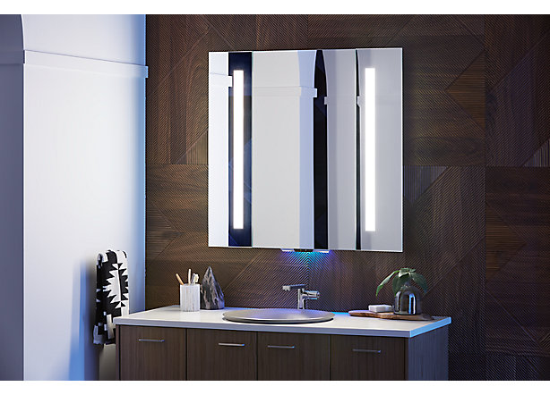 Voice-lighted bathroom mirror