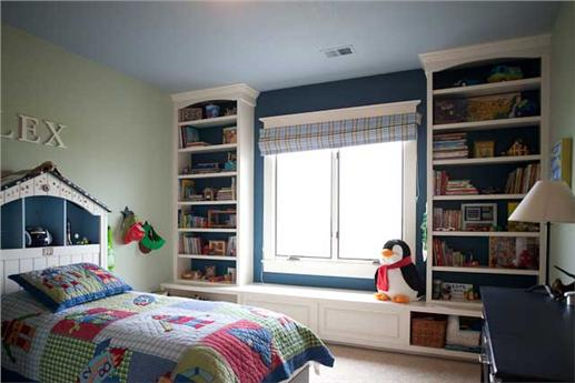 Kids bedroom with shelves and window seat.