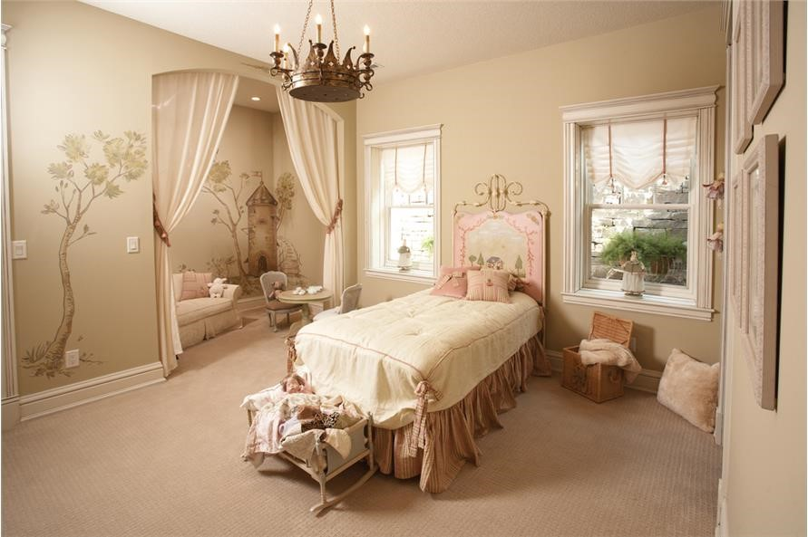 Girl's bedroom with attractive, comfortable sitting area in 1-story 4-bedroom Craftsman style home