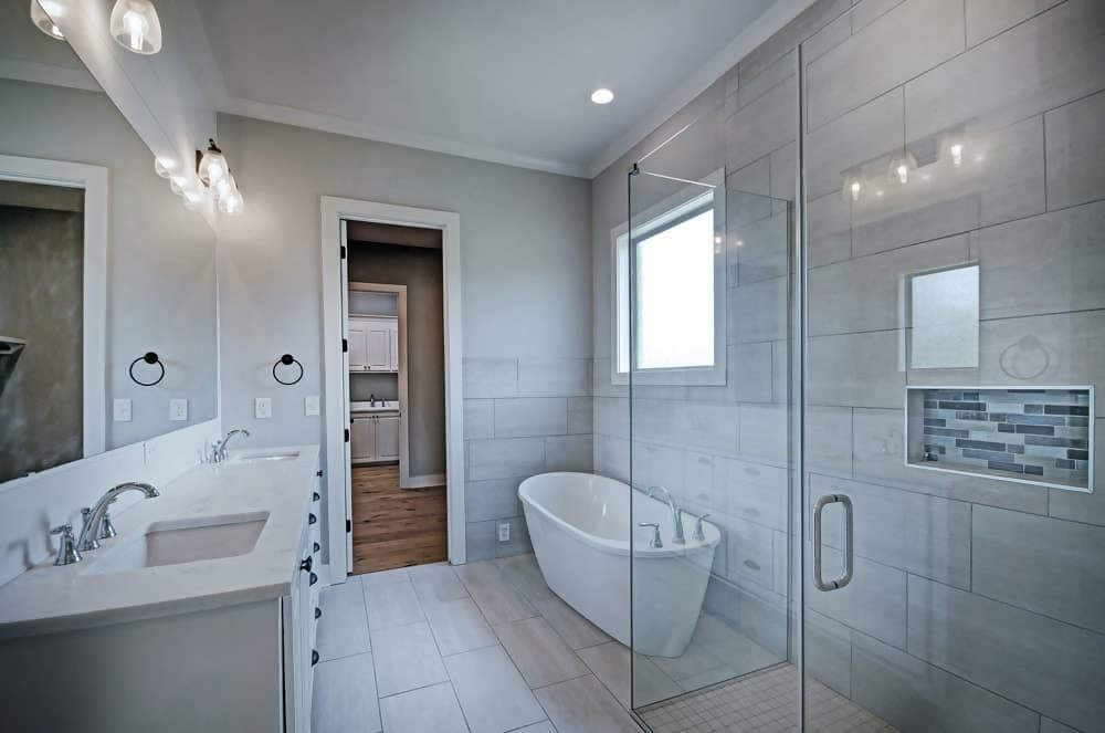 Bathroom with neutral color scheme, accented by a touch of color in the shower