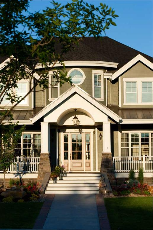 Front door of Craftsman style home with Shingle style exterior