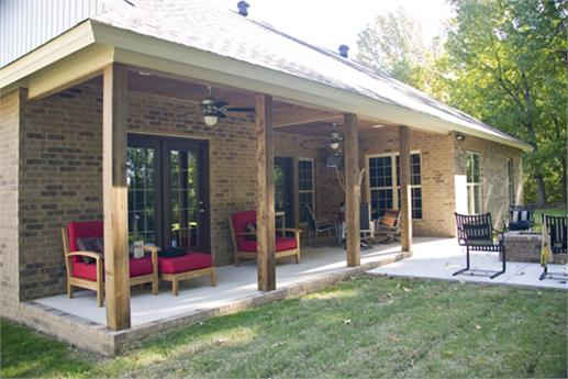 Note the dark wood sliding glass door that opens out to the spacious covered rear porch