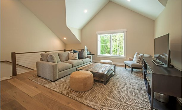 Vaulted bonus space that can be a work-study space, getaway room, entertainment corner, or yoga-meditation nook