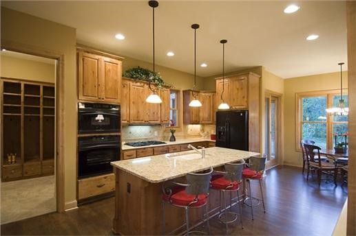 Wood-toned kitchen with center island in house plan #109-1191