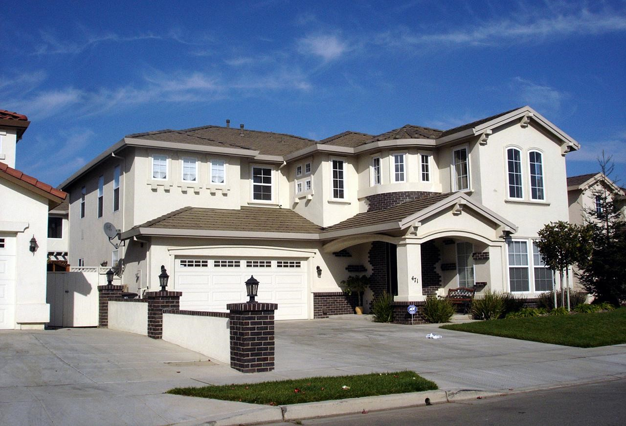 Large McMansion type home with mismatched windows