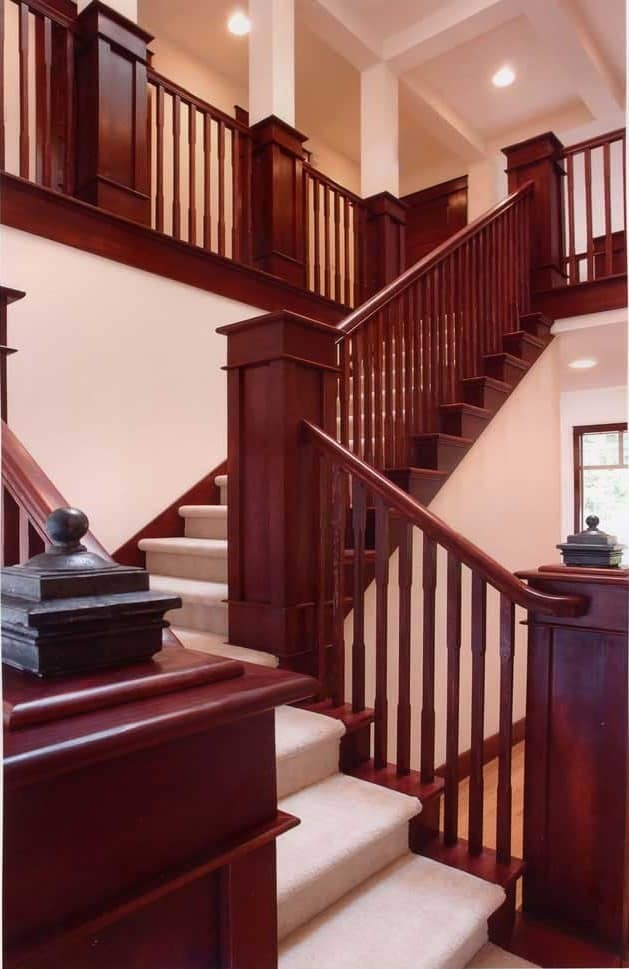 Wood staircase with square balusters in a two-story home