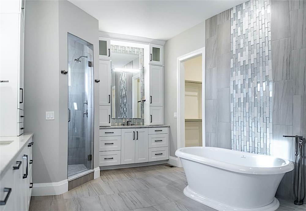 Master bathroom with large porcelain tiles that look like wood flooring