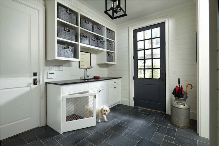 Living space for a family dog built into the side entrance area of a home