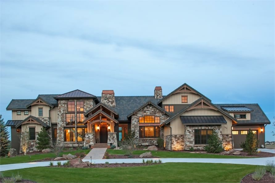 Rustic luxury home in the manner of a European country manor with stone and stucco siding