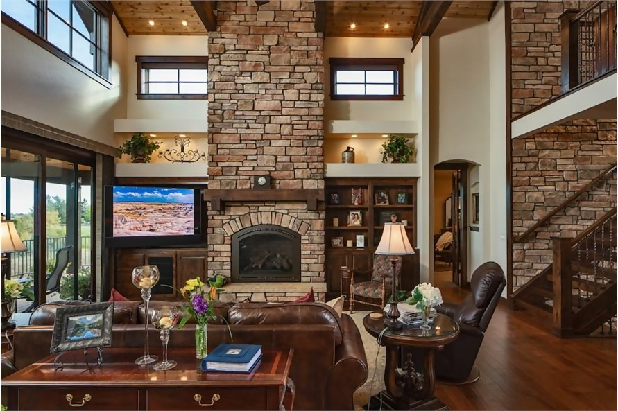 Beautiful Great Room with tall stone fireplace and other rustic accents