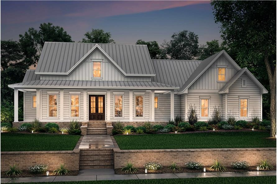Farmhouse style home with standing-seam metal roof and white siding