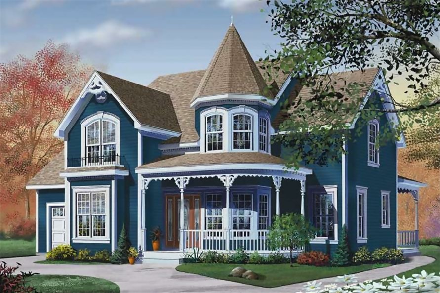 Blue Victorian style home with turret and front porch with gingerbread trim