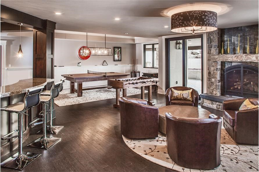Game room and bar area in the basement of a luxury home