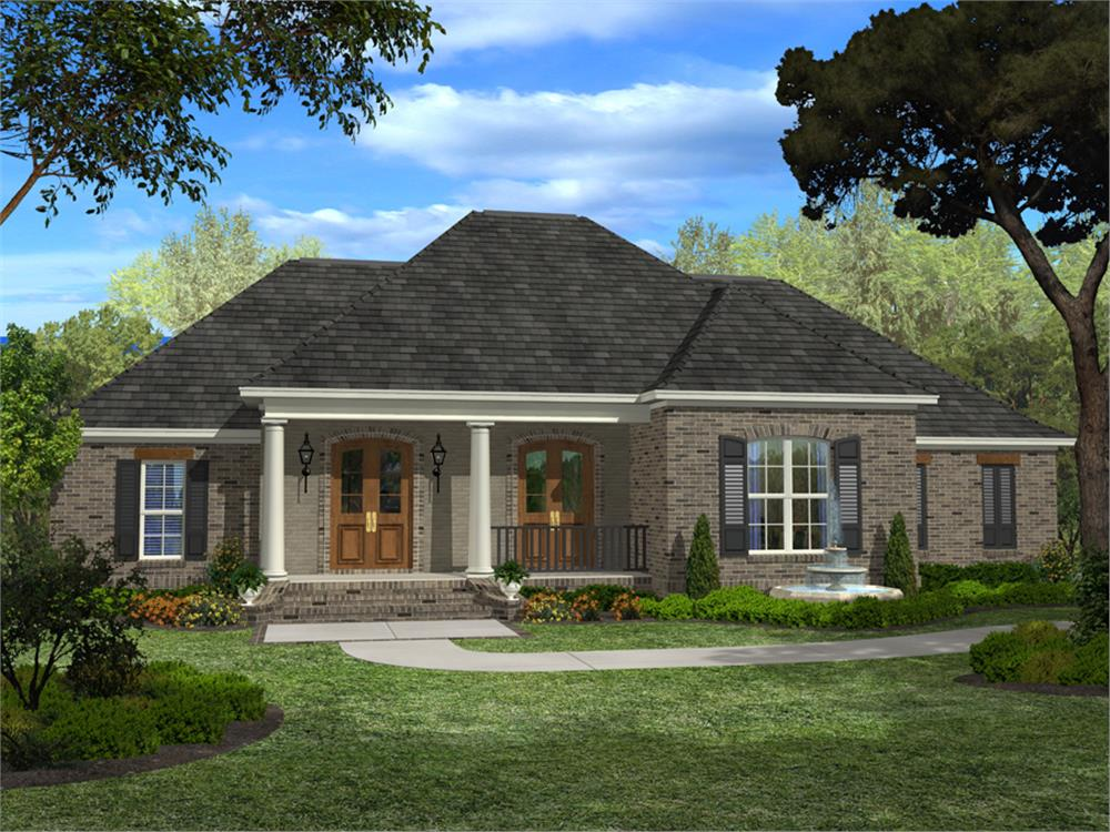 Acadian style home with brick exterior and front porch with large columns