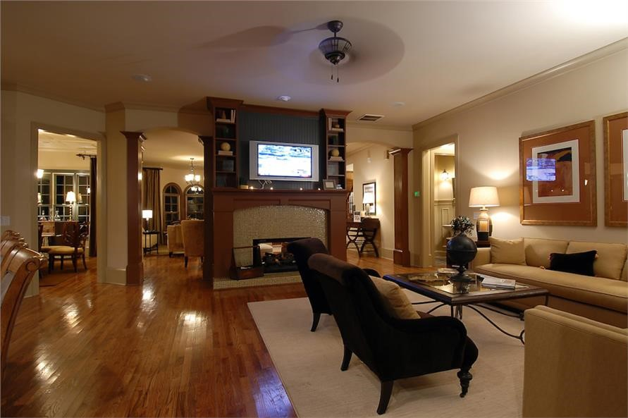 Fireplace with television above it in open-plan living area