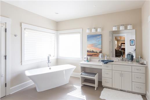 Photo of bathroom with amazing tub.