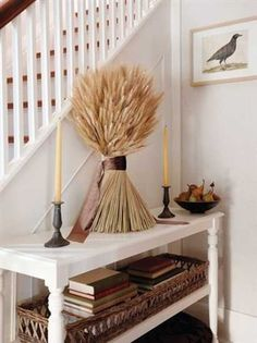 Wheat-sheaf-adorned table in a home entryway