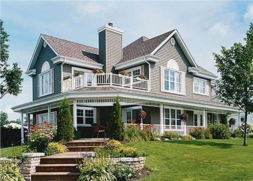 Large farmhouse style plan with sizable wrap around porch and beautiful landscaping.