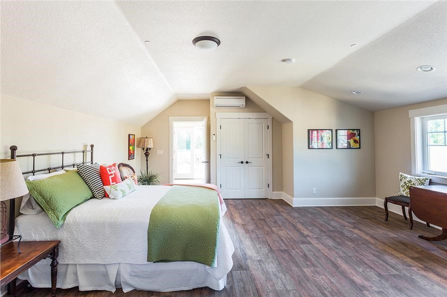 Spacious and homey guest bedroom in a 2-story, 3,815-sq.-ft. Craftsman style home