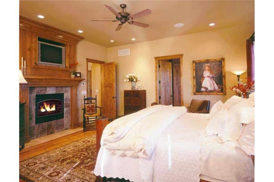Cozy master bedroom complete with its own fireplace for warmth and atmosphere