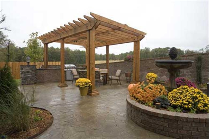 Beautifully hardscaped backyard with natural-wood pergola