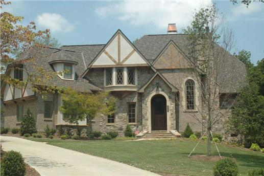 Traditional two-story, four bedroom Tudor-style home with the half-timbered exterior