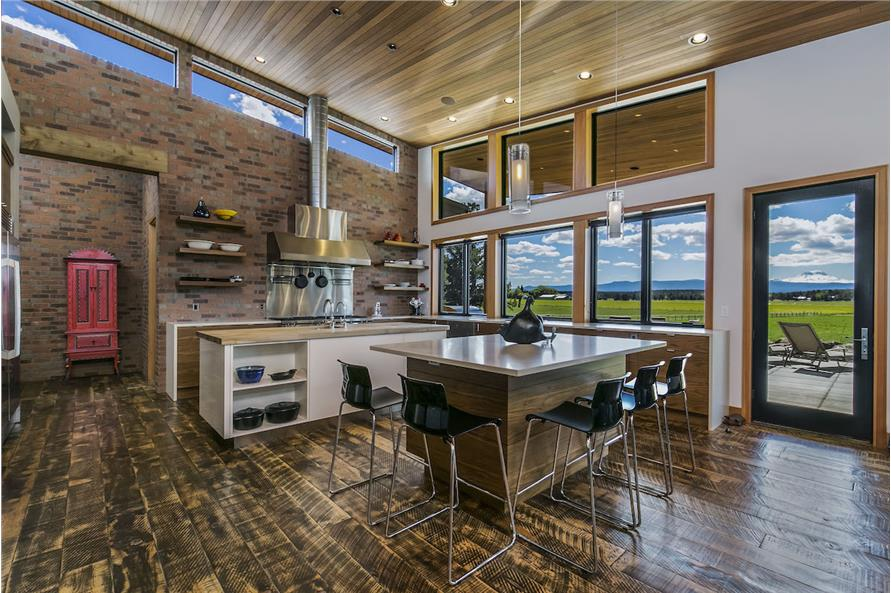 Two separate islands, one dedicated to eating, in a Mid-Century Modern home