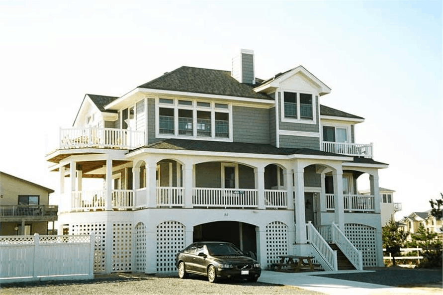 Coastal home with raised foundation and multiple covered decks for great views
