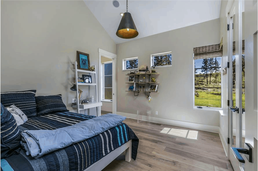 Bedroom in Contemporary style home that's decorated in blue solids and patterns