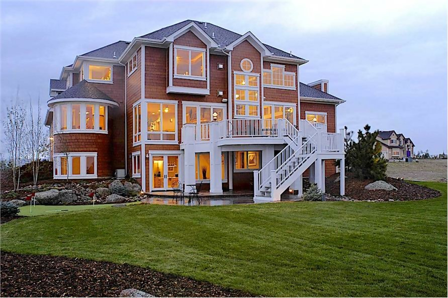 Two-story Shingle style home with white trim and walk-out finished basement