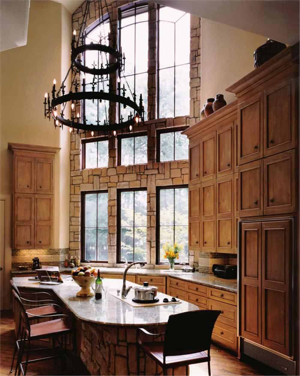 Rustic, European-style kitchen with impressive chandelier