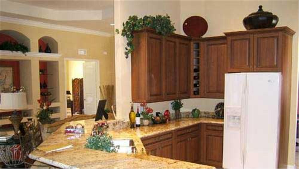 Kitchen showing trailing ivy plant in House Plan #133-1029
