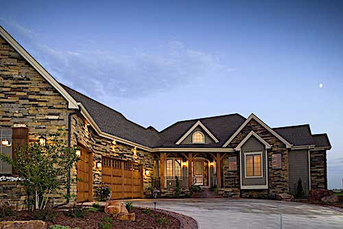 Rustic transitional Craftsman style home with stacked-stone siding