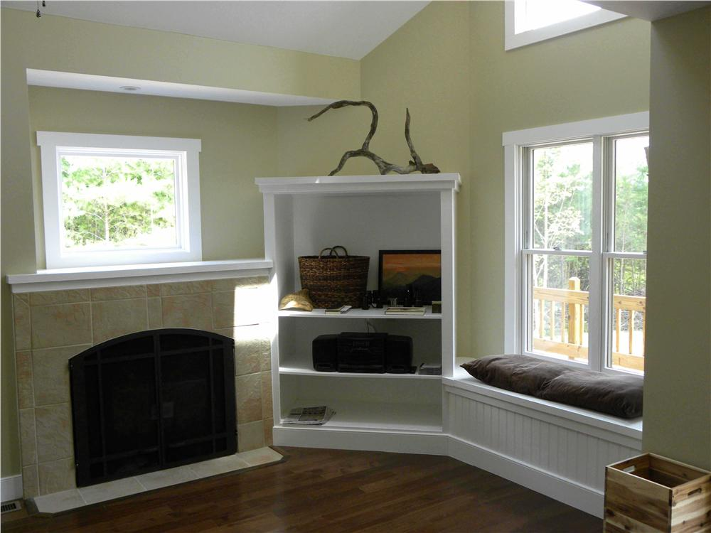 Great room in House P;an #160-1015 looking at fireplace/window seat
