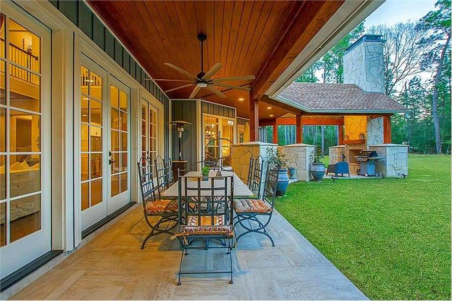 Patio outside the Great Room of a luxury home with multiple large patio doors