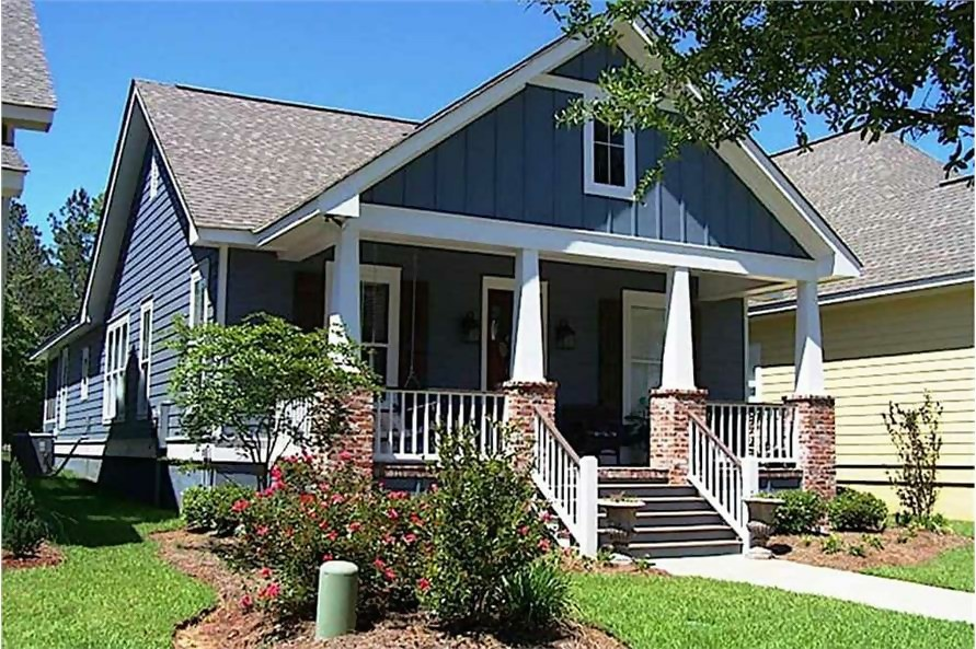 1-story Bungalow Cottage with gable roof and inviting front porch with massive columns set on brick pedestals