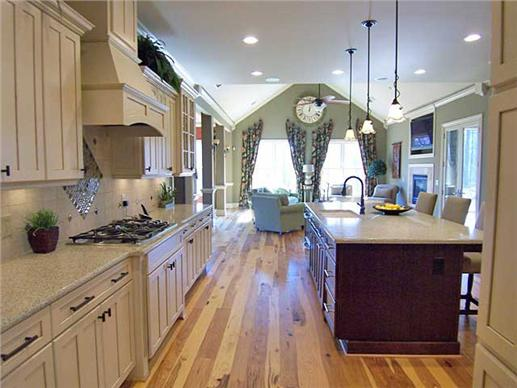 open chef's kitchen with layout that works in an adaptable - universal home plan