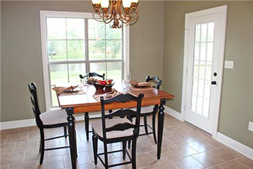 Dining room with French door  in Country style home