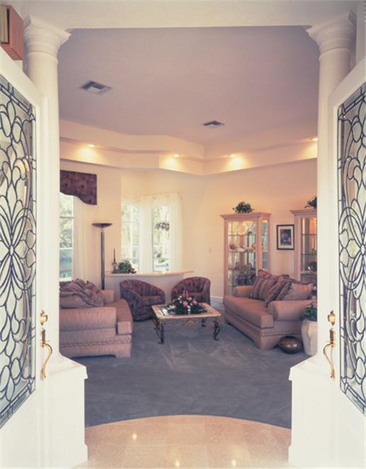 A pair of front doors with leaded glass panels that opens to a roomy Great Room