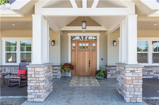 Photo of craftsman style entry of a brand new home.