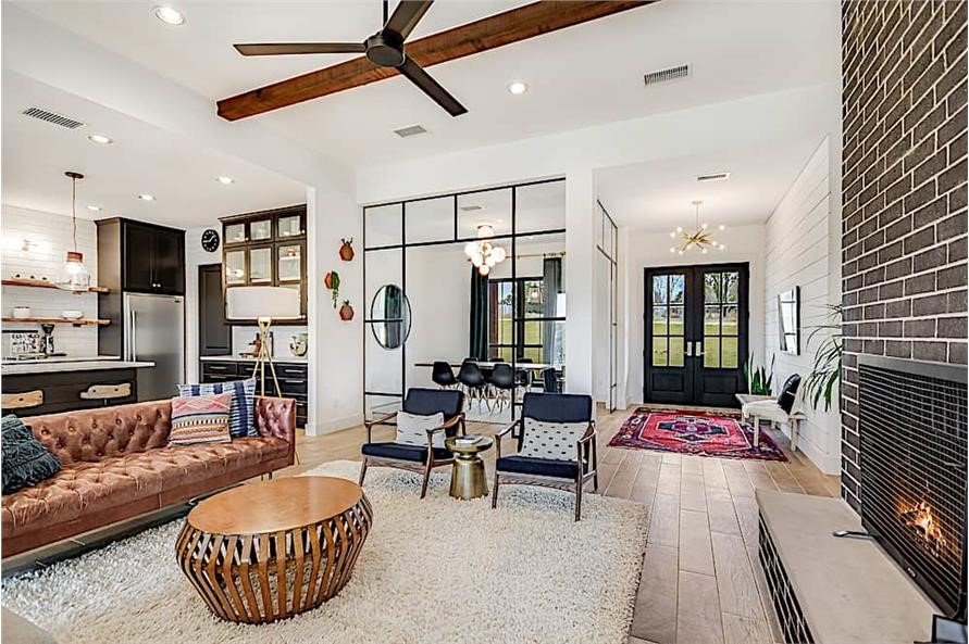 Open-floor-plan Great Room with fireplace and ceiling fan