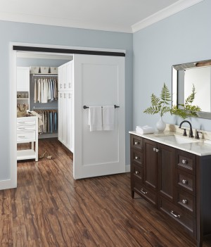Wall-mount sliding barn door uses Johnson Hardware