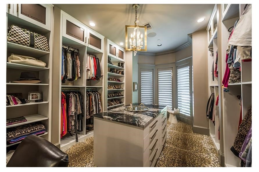 Large master bedroom walk-in closet with storage island in the middle