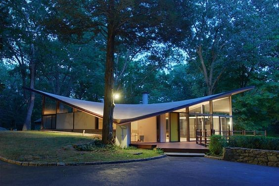 Midcentury modern home with gull-wing roof
