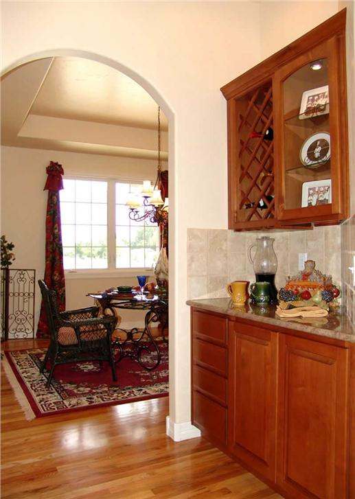Arched entryway to the breakfast nook-pantry area in 2-story, 4 bedroom French home