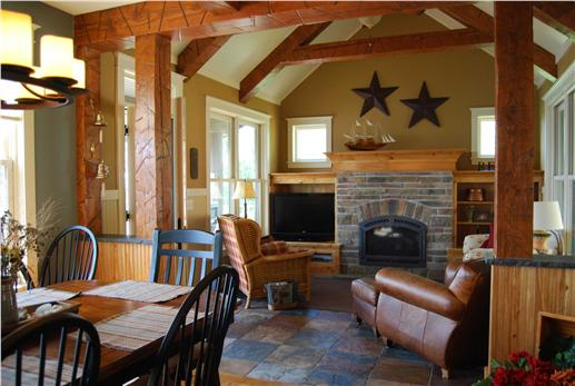 Family room with fireplace, wood beams.