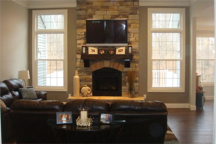 Fireplace with brick facing in family room of house plan 120-2548