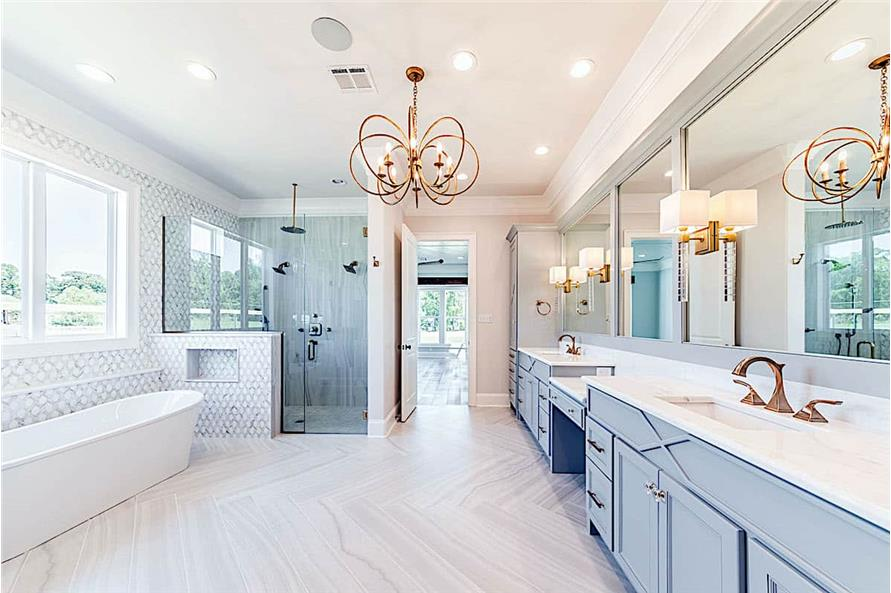 Large bathroom with integrated lighting: recessed ceiling lights, chandelier, sconces, and hanging lights